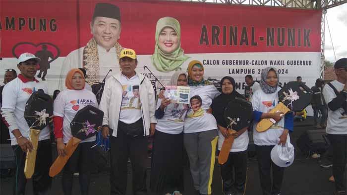 Jamaludin Menangkan Undian Umroh Jalan Sehat Bersama Arinal